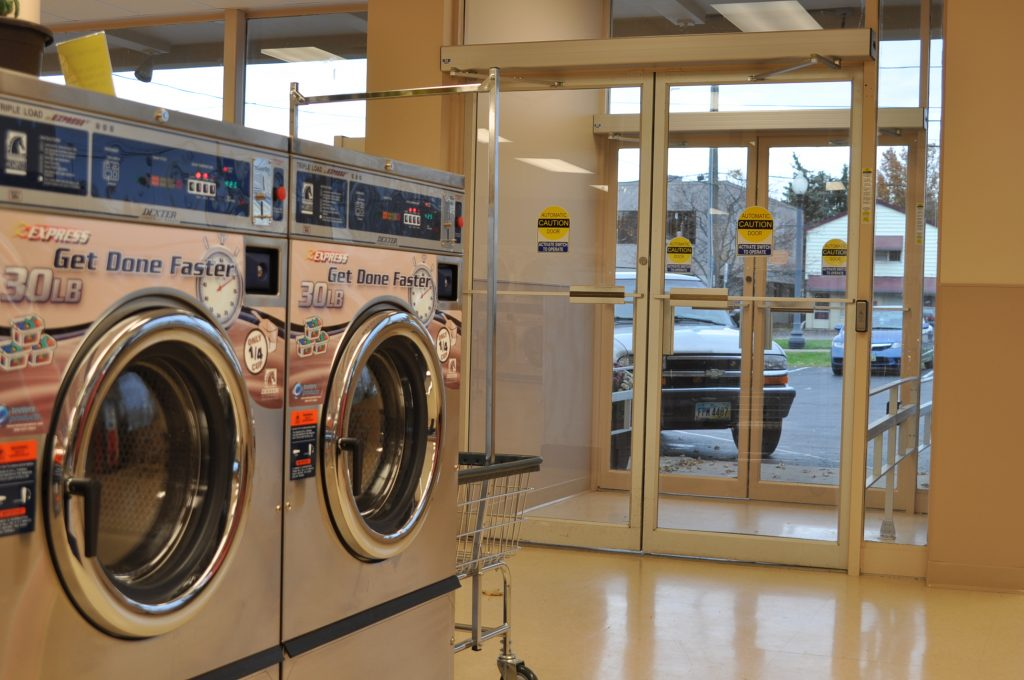 Photo of automatic doors for convenience at a laundromat