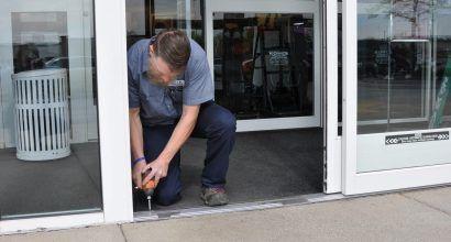 Photo of a door technician working on a door threshold