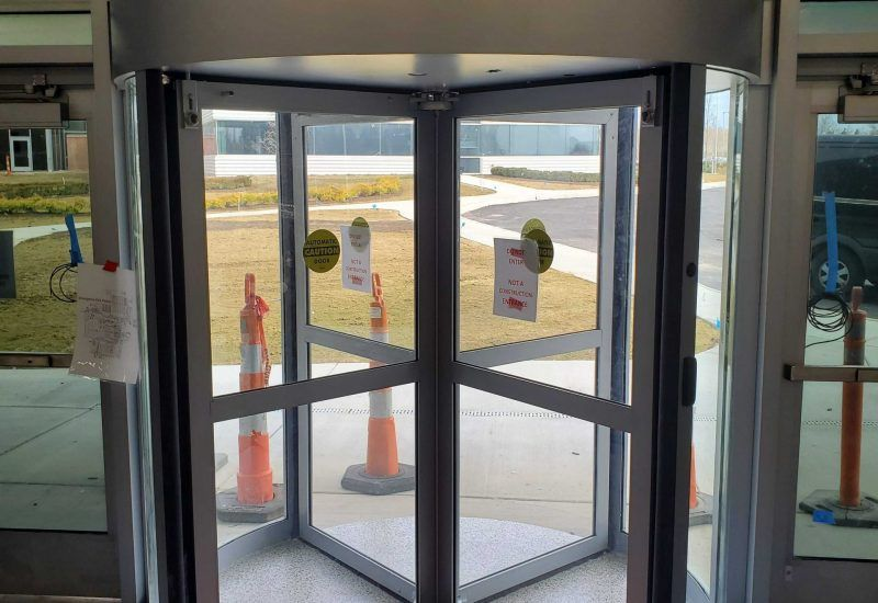 Photo of an automatic revolving door being installed in a building