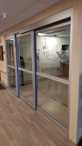 Photo of a large manual sliding door in a medical facility
