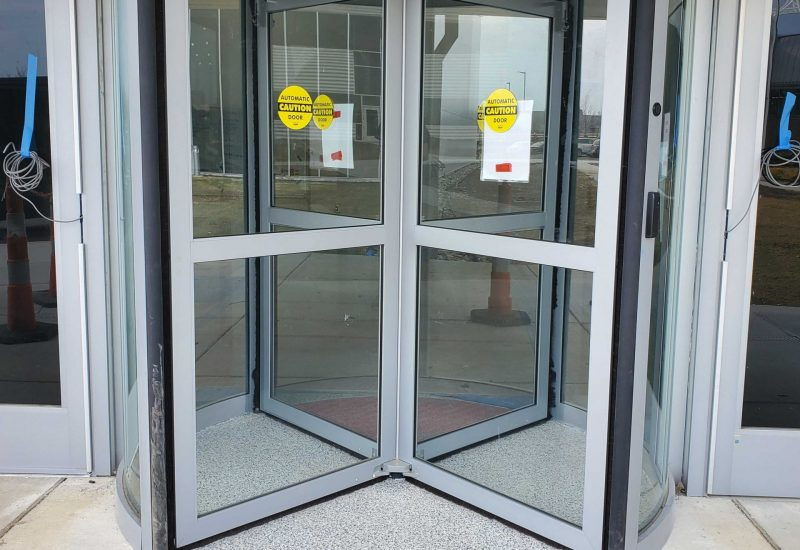 Close-up of an automatic revolving door installed in a pharmaceutical company