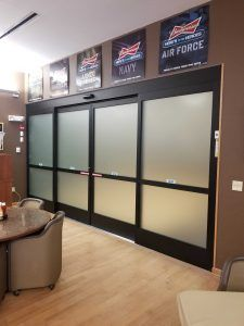 Photo of automatic sliding doors with frosted glass