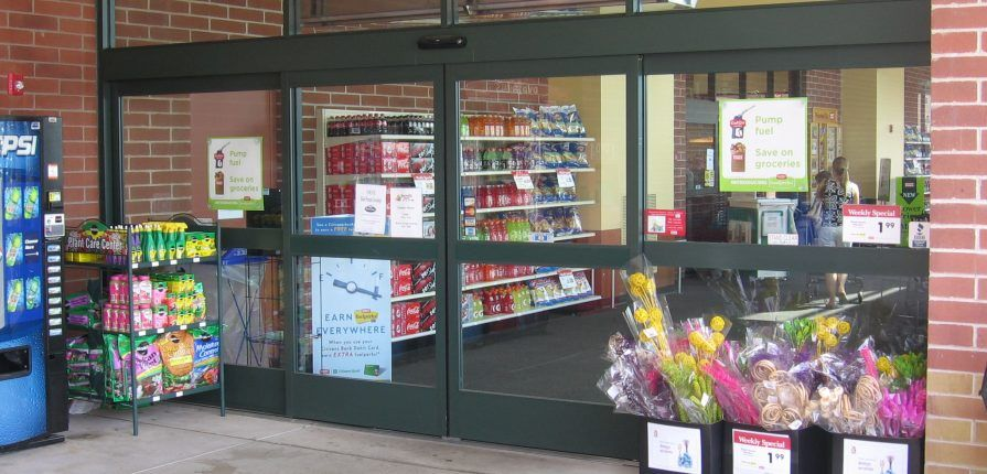 Sliding door obstructed by sales displays